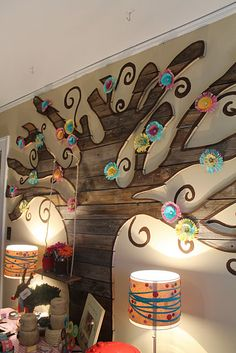 Salvaged wood used to make this decorative tree wall display; Flowers are actual cupcake liners