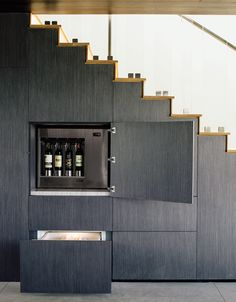 The clever architects who designed these seven homes spared no expense in the staircases, incorporating hidden storage, rolling bar carts, and even an office nook into the under-utilized spaces beneath them.