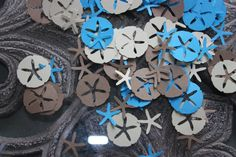 Great for party tables by the sea. 300 Sand Dollar and Starfish by NewCreationsCo on Etsy, $2.10