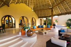 True outdoor living in this Mexican villa with a palapa roof.