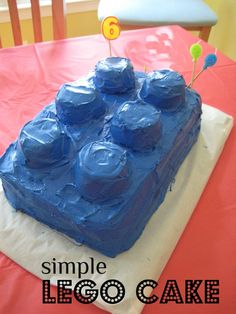 Lego Birthday Party!  Cake, Centerpiece, and decor ideas (build a lego bucket for silverware). All cheap and frugal.