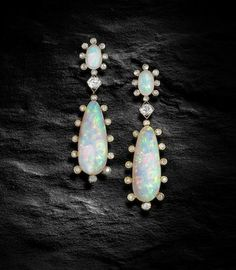 A pair of opal and diamond pendent earrings,