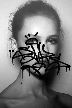 Symmetry Symptom graffiti over model