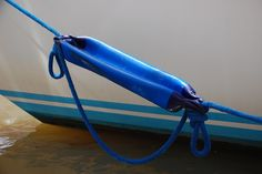 DIY for liveaboards and boaters of all kinds - Manage surge with snubbers made from deflated fenders.