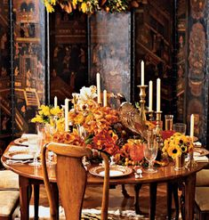 Thanksgiving table setting. The screen behind is the nicest feature to the room.