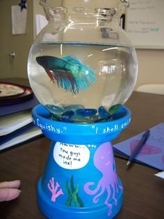 A cute little beta fish bowl idea! Briadan made me a vase for mothers day just like it, i put a candle on top. but i love this much better Clay Pot Projects, Clay Pot Crafts, Crafts To Make, Fun Crafts, Crafts For Kids, Tree Crafts, Flower Pot People, Clay Pot People, Flower Pot Crafts
