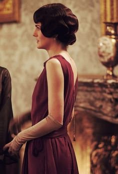 downton abbey 1920s dress I love the jewel that hangs down the back