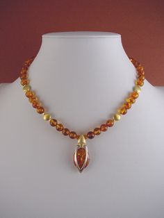 Genuine Baltic Amber & Vermeil Necklace - Unique Amber Jewelry by Kotty - Statement Necklace by KottyArtwear on Etsy https://www.etsy.com/listing/207802830/genuine-baltic-amber-vermeil-necklace