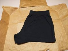Make a Pair of Comfy Shorts Out of an Old T-shirt : 5 Steps (with Pictures) - Instructables Diy Shorts, Shirt Diy, Comfy Shorts, Scarf Shirt, Shirt Refashion, T Shirt And Shorts, T Shirt Yarn, How To Make Scarf, How To Make Shorts