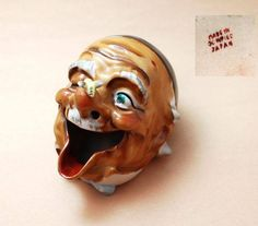 """Occupied Japan Collectors Interesting ashtray, man's face with a bee on his nose, 3"""" tall and 3"""" wide, marked Made in Occupied Japan. Smoke will come out of his nostrils. Shoko Tanaka Collection"""