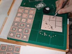 A whole lot of work, working with 1x1 mm. One square with mini tiles takes about 1,5 hour to make, by Marja Keuker