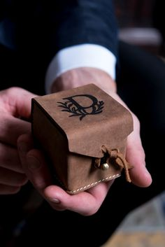 Here is an impressive little box that is packed with personality. The tanned leather and informal design make this perfectly suited for a range of wedding styles. Whether rustic country or urban industrial, your wedding rings will make an impressive debut for their walk down the aisle. Personalized with a distinctive laser-etched monogram, this oh-so special box is truly one-of-a-kind.