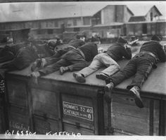WW1. Belgian soldiers taking aim from atop of train car.(National Library of France)