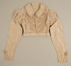 Cream silk Spencer jacket, circa 1820. Metropolitan Museum of Art