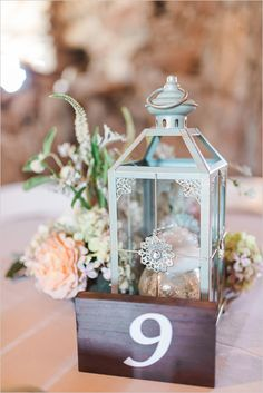 love the pale blue lantern against the dark wood table number for a rustic wedding centerpiece ~  we ❤ this! moncheribridals.com
