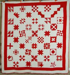 """Friendship Sampler, 1870-80s; Belmont, Ohio, stamped/stencilled names incl: Mrs. J. Ramse, Mrs. A. Delong, Mrs. N. White, Mrs. Bell Hammond, Ana Underzber, S.L. Kirland; 78"""" x 84""""; hand quilted at 8-9 spi; white backing, hand stitched red binding, cotton patting, some conversation prints"""