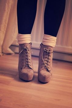 Adorable lace up tan ankle boot with heel. The ankle socks are a nice touch.