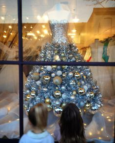 """This one is a personal family picture of my two grand-nieces, completely mesmerized by this """"Christmas Tree Gown"""". You can just imagine how dreams begin.."""