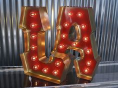 This LA sign brings Hollywood to You! With his metallic Gilded Gold spray edging and Candy Apple Red interior, these LA letters are like hosting a glam 1940's movie-star in your home or business.