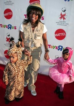 Pin for Later: The Best Celebrity Family Halloween Costumes Angela Bassett and Her Twins as a Zookeeper, a Giraffe, and a Flamingo
