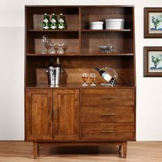 Create a welcoming environment with the Danish Highboy buffet. Crafted of durable wood and capped with beautiful veneers, this cabinet features a gorgeous Autumn Oak finish.
