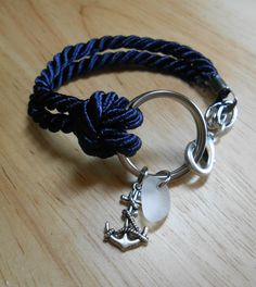 Cute braided bracelet.  might add a more dainty anchor charm though...Sea Glass Jewelry - Nautical Ring Bracelet - TRAVELLER