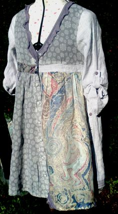 Upcycled cotton, linen, polyester, summer dress 'Kokopelli' on dummy.  Hand painted silk panel at front. Design of Hopi Indian flute player, 'Kokopelli' - design embroidered on flute player, feathers and spirals. http://shamanicnights.com/shop%20pages/smock%20dress.html
