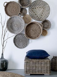 shallow baskets as wall hangings.  Could spray paint them all the same color and add a circular picture on each one.