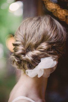 twist chignon with silk flowers