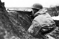 German paratrooper armed with an MP-40 submachine gun, in the trench on the Eastern Front; winter of 1942-1943.
