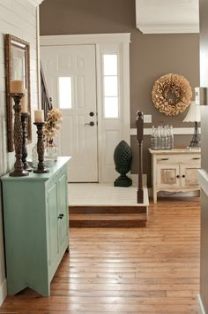Loving all the neutrals with the pop of turquoise. Great turquoise cabinet and the distressed offwhite cabinet against the wall.