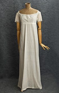 1780s open robe; The quintessential and revolutionary Neoclassical style: the Empire waist; wide, open neckline; and a small back train. The peerless Directoire dress is covered with opaque white Bohemian glass bugle beads.