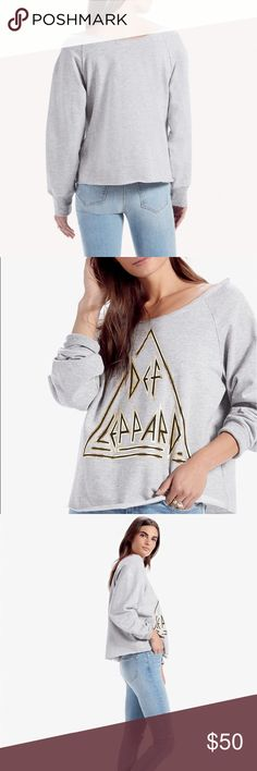 """DEF LEPPARD PULLOVER Super comfy and soft Lucky Brand pullover featuring Def Leppard! Has a scoop open neck and loose hem line.   • Size XS • Brand New With Tags • Length: 22"""" Width pit to pit: 20"""" Arm Length: 24.5"""" • 90% cotton 10% polyester • The lettering has a metallic feel Lucky Brand Tops Sweatshirts & Hoodies"""