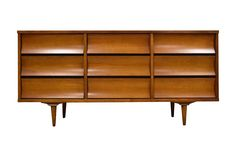 A mid century modern nine drawer walnut dresser with a formica top made by Johnson Carper.