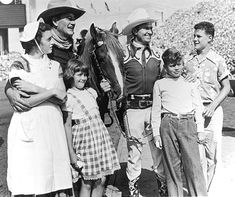 RODEO PERSONAL APPEARANCES - John Wayne & his children Toni, Melinda, Pat & Michael pose with Gene Autry & 'Champion' - Los Angeles Sheriff's Rodeo - 'The Largest One-Day Rodeo in America' - Los Angeles, California -  Early 1950s.