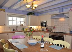 Love the mix of pastels in this holiday cottage kitchen