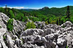 Trademark colors of Velebit; blue, green and white, come together in the view from the cliffs of Bijele Stijene towards Bačić Kuk (1304m) and Dabarski Kukovi