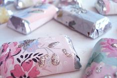I love the idea of rewrapping mini chocolate candy bars with wrapping or scrapebooking paper to customize your table