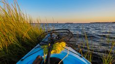 Fishing from a kayak in the marsh grass on the White Oak River looking towards Swansboro, NC