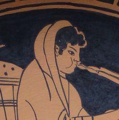 Suonatore di flauto copia soggetto greco antico. Greek pottery replica on terracotta plate