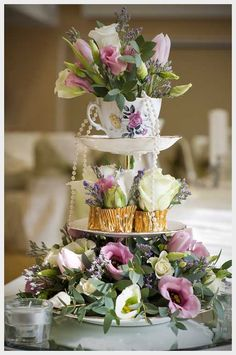 Vintage 3-tier cupcake stand embellished with pearls, a china teacup, gold chocolate wrappers, & best of all, fresh flowers.