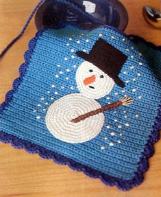 I would make a dishcloth out of it....Crochet a Snowman Baby Bib, free pattern