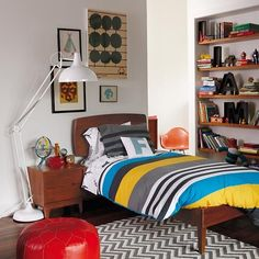 Vintage boys room, teak furniture and lots of shelving for all those book