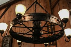 Wagon Wheel Chandelier!  - From Etsy: Large cast iron and steel wagon wheel, circa late 1800s. This original wheel was made into a (6) light, up-lit chandelier. The dimensions are: