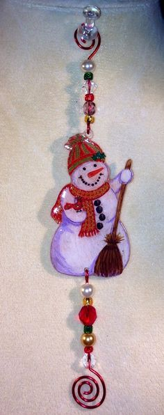 Shrink plastic ornament with glass beads