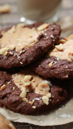 Recipe with video instructions: Peanut butter fiend? These cookies will guarantee you your daily fix! Ingredients: 220g rye flour, 200g dark chocolate, 120ml olive oil, 50g salted peanuts, roughly chopped, 6 tsp smooth peanut butter, good quality, 150g soft brown sugar, Pinch of sea salt, 1 tsp baking powder, 100ml non dairy milk