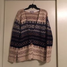 Oversized sweater. Oversized sweater bought at a boutique. Bought without trying it on and it doesn't fit me exactly how I thought it would. Would be super cute with tights and boots! Sweaters