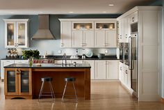 White Cabinets and boxed in fridge