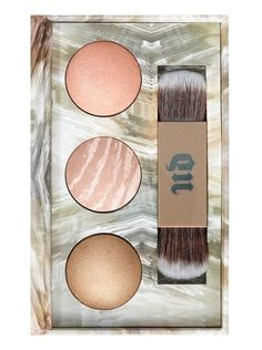 This limited-edition set contains three new shades of Urban Decay's coveted Shimmering Powder for the face and body. Naked Illuminated is a lightweight, baked powder with a sophisticated, microfine Naked shimmer. Each shade contains light-reflecting particles that give the skin a luminous look. Simply dust on this smooth, silky powder wherever create an instant glow—for a radiant Naked look from head to toe.
