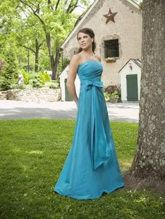 Strapless taffeta A-line gown with softly side draped bodice, waistband accented with tailored bow and long streamers, skirt with concealed side pockets. Removable straps included. Free made-to-measurement service for any size. Available colors seen as in Color Options.